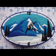 Reloj de fieltro montañas.